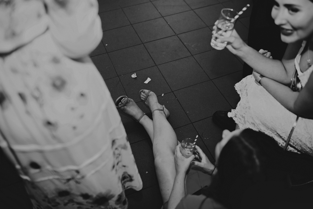 guests sittign on floor at Stoke Newington Wedding | Lisa Jane Photography | Modern London Wedding Photography