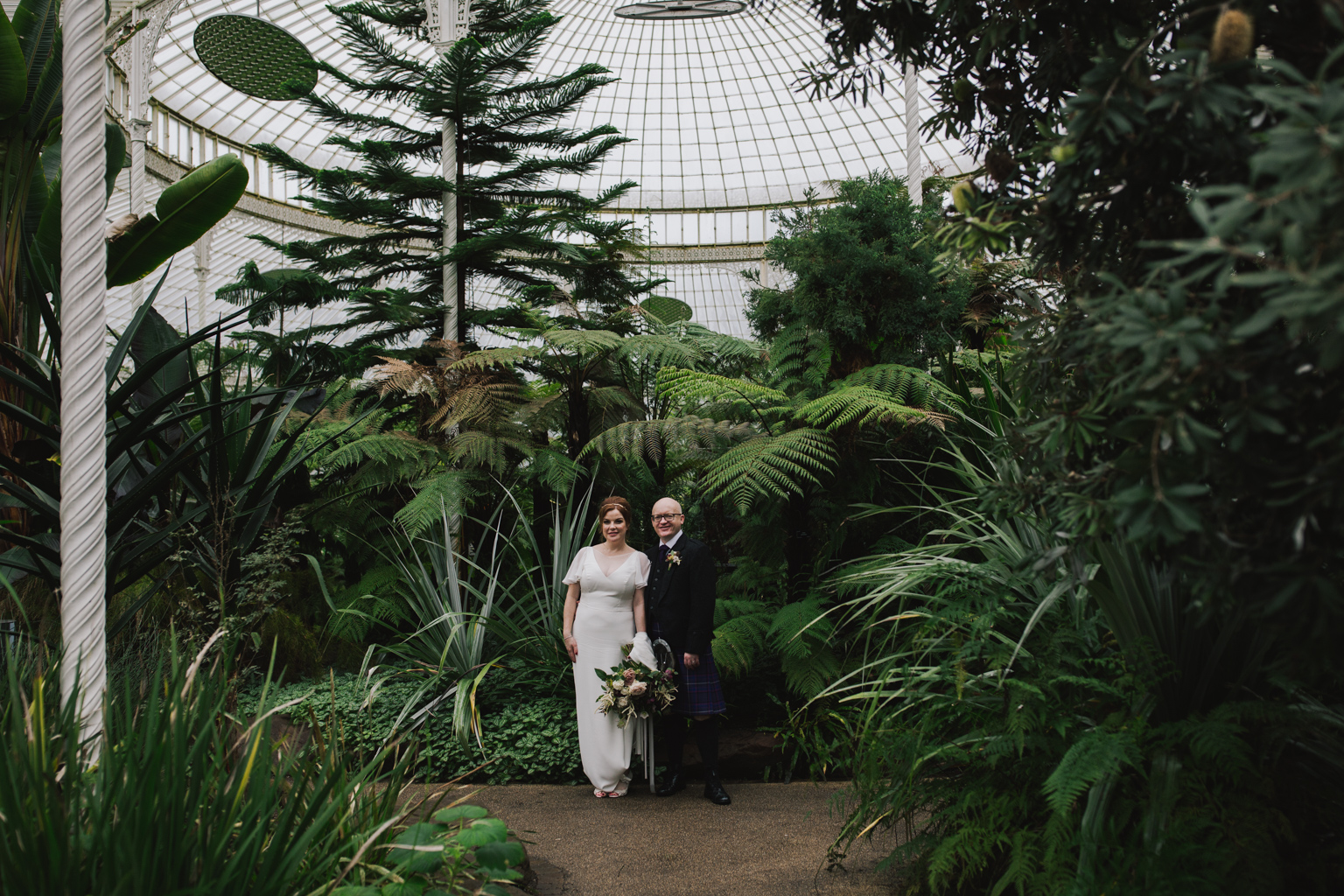 Wedding portraits in the glasshouse at a Glasgow Botanic Gardens Wedding