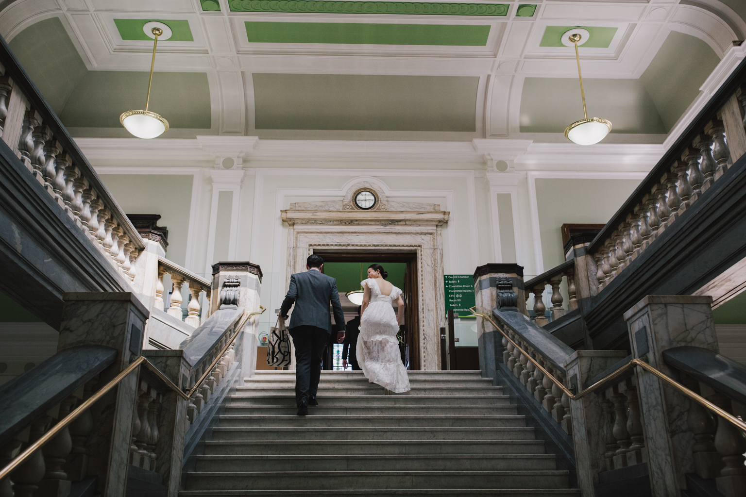 bride and groom walking to ceremony room at their Islington Town Hall Elopement