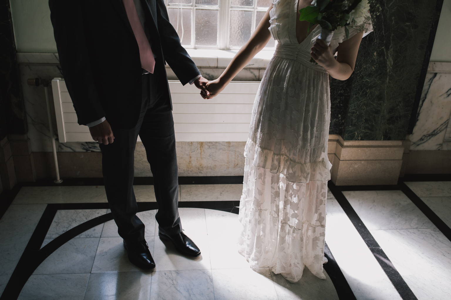 bride and groom holding hands during Islington Town Hall Elopement