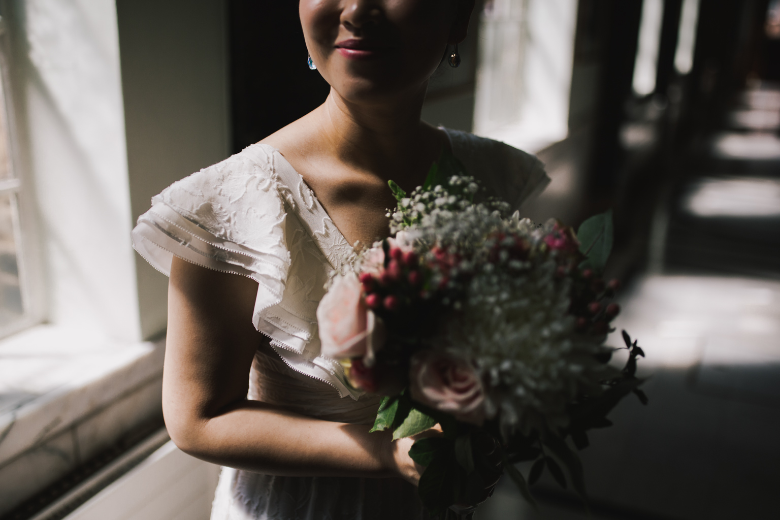 Bride with flowers in Islington Town Hall