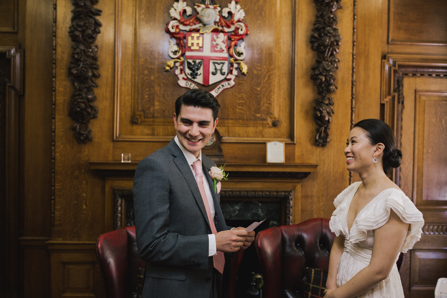 Groom reading wedding vows during Islington Town Hall Elopement