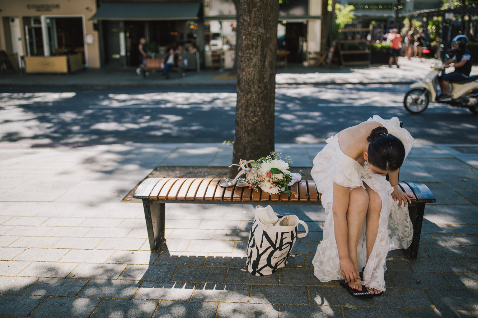 Bride changing shoes outside Islington Town Hall by Lisa Jane Photography