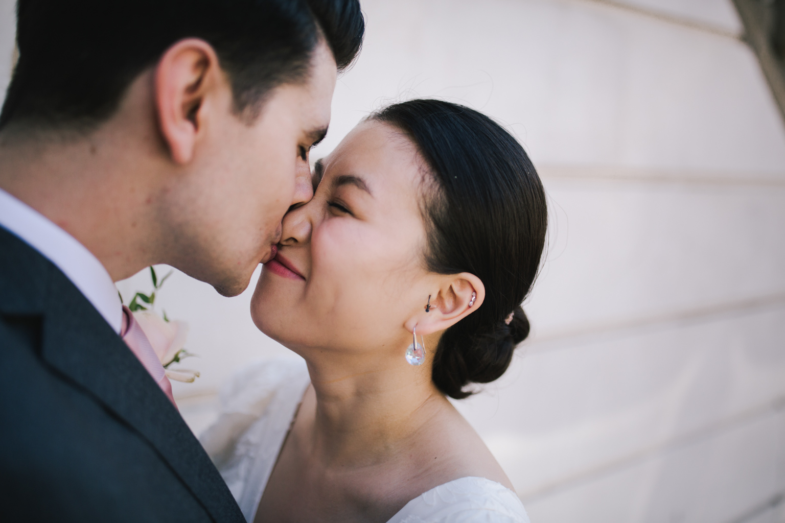 cute moment between bride and groom at London Town Hall wedding