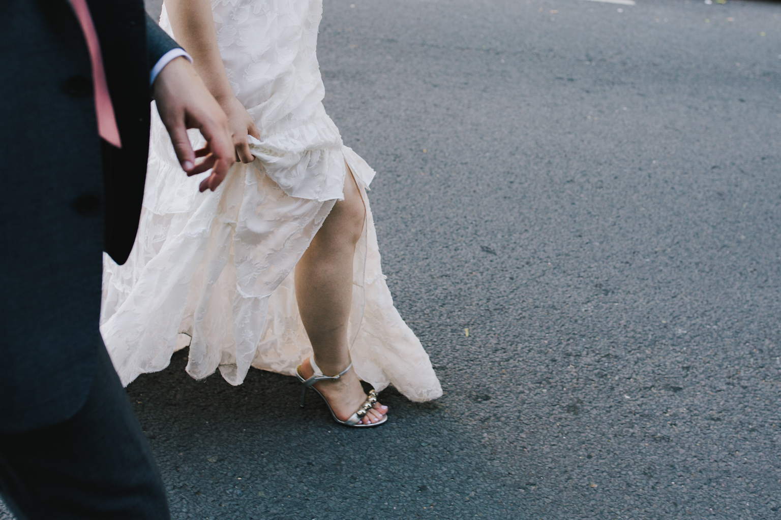 Bride walking the back streets behind Islington Town Hall