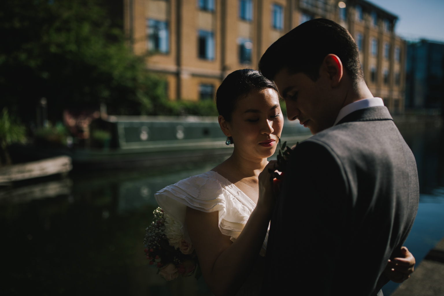 Bride and groom portrait by the canal at Islington Town Hall Elopement