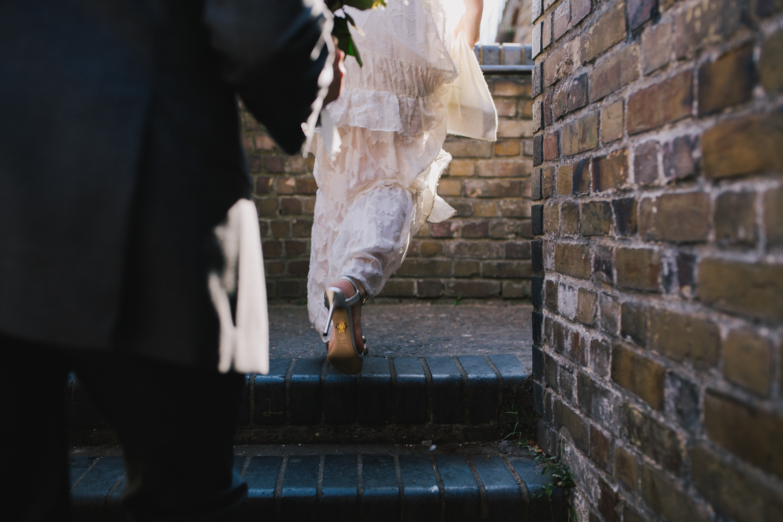 Bride walking to Islington Town Hall Elopement