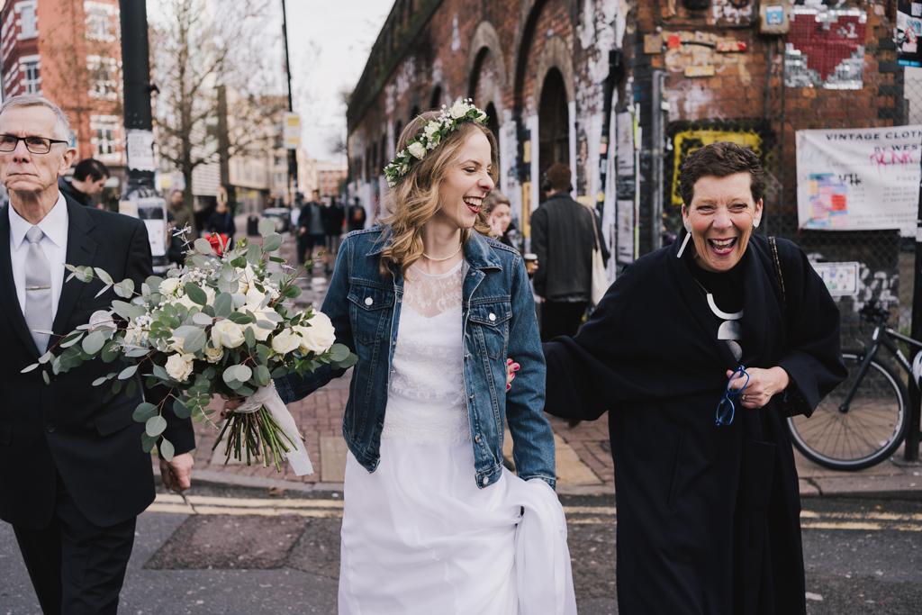 Bride walking through Shoreditch | Shoreditch Studios Wedding | Modern Wedding Photography