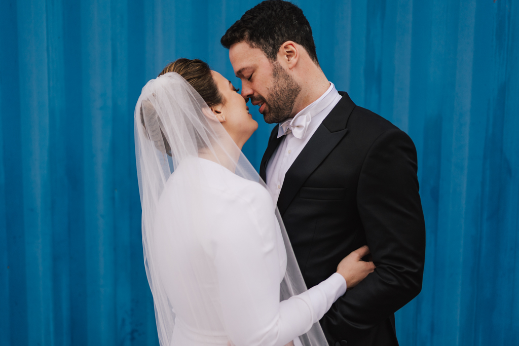 Bride and groom first kiss at a Electrcians Shop Wedding by Lisa Jane Photography