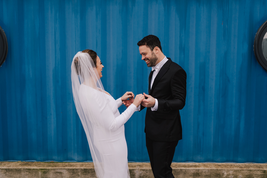 Bride and groom during first look at a Electrcians Shop Wedding by Lisa Jane Photography