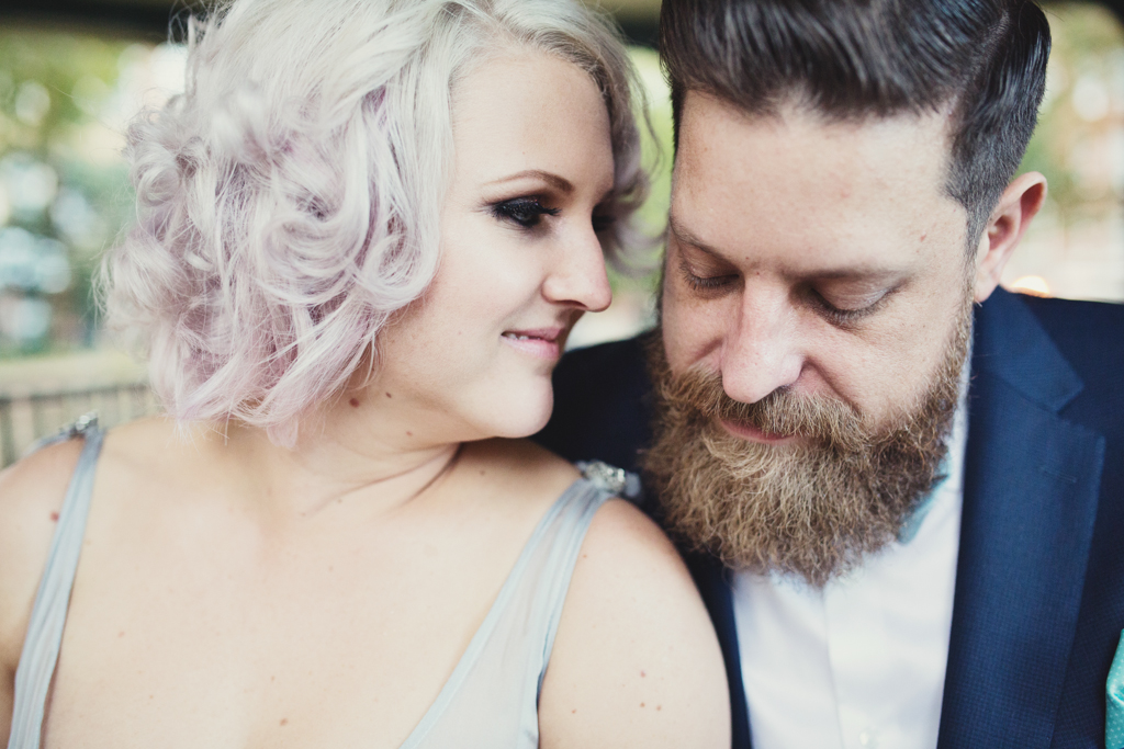 Pink haired bride and bearded groom