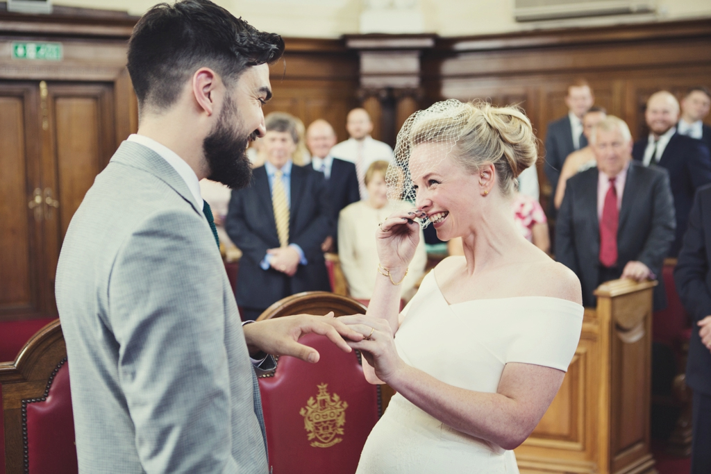 Bridal giggles during Islington Town Hall ceremony