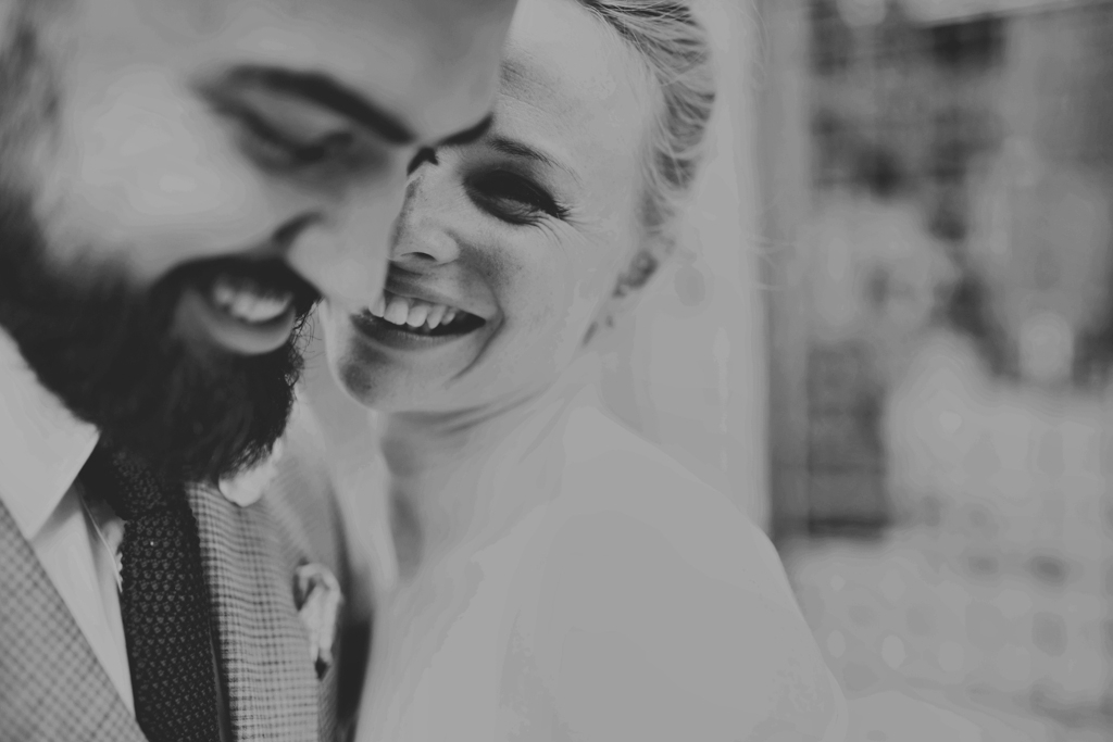 Beautiful smiling bride, with groom London by Lisa Jane Photography
