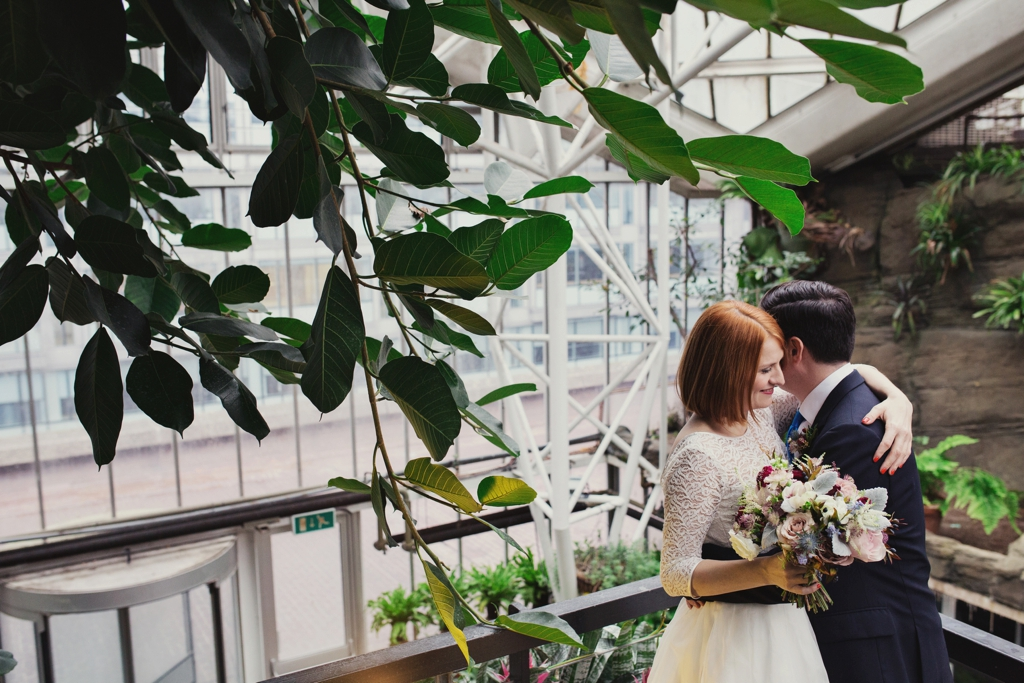 Fur Coat No Knickers bride with groom holding Petalon Flowers bouquet London