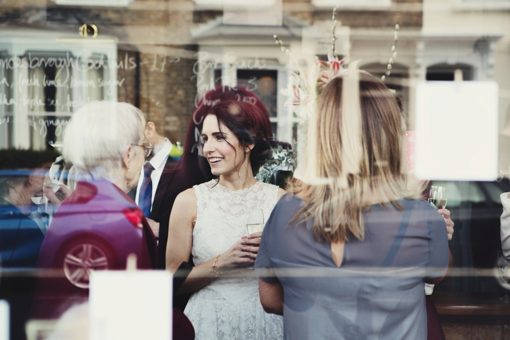Vintage bride celebrating at The Londesborough pub wedding London