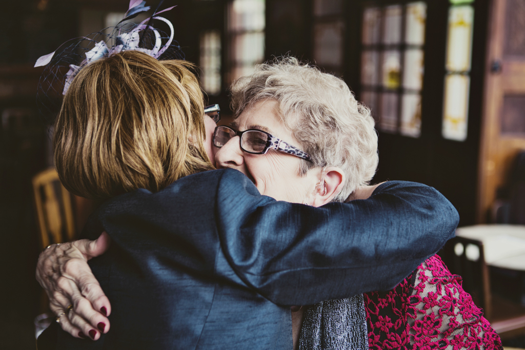 Guests hugging at a london pub wedding