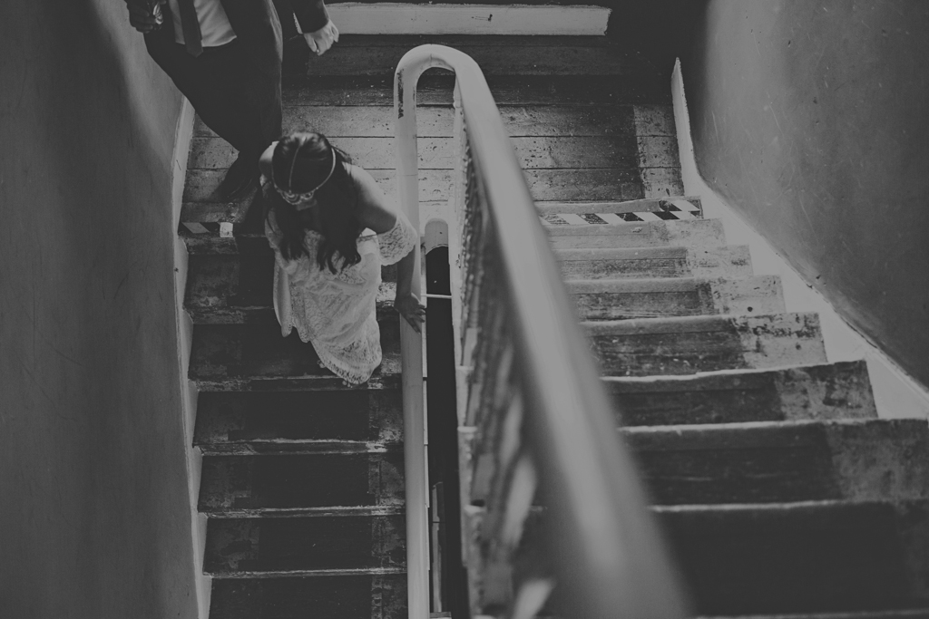 bride and groom walking down the stairs at the Roost in Hackney