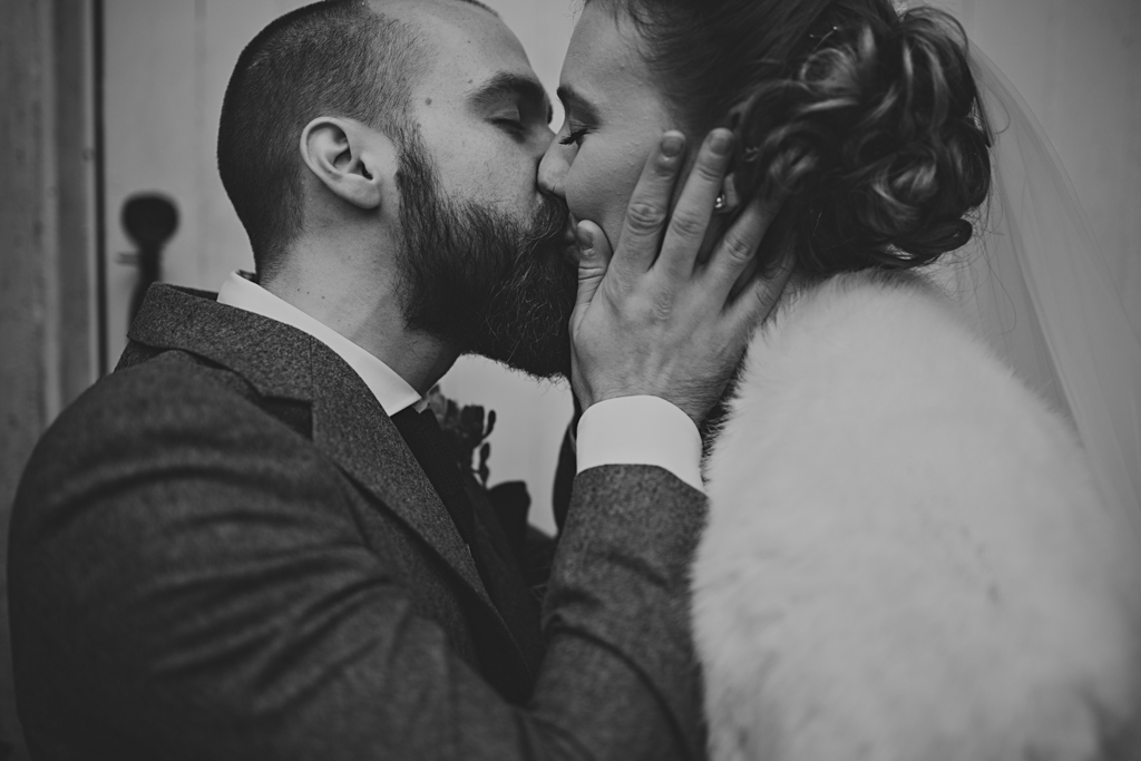 Passionate kiss at a Northbrook Park wedding by Lisa Jane Photography