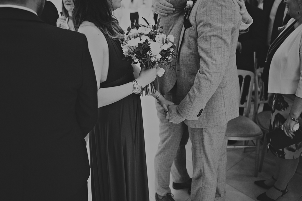 moments at a wedding a supporting hand at a london wedding by Lisa Jane Photography