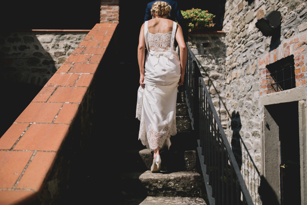 bride and groom walking up stairs at an Italian wedding