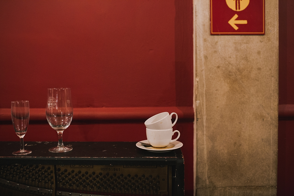 Empty glasses and coffee cups at the end of a wedding at Battersea Arts Centre by Lisa Jane Photography