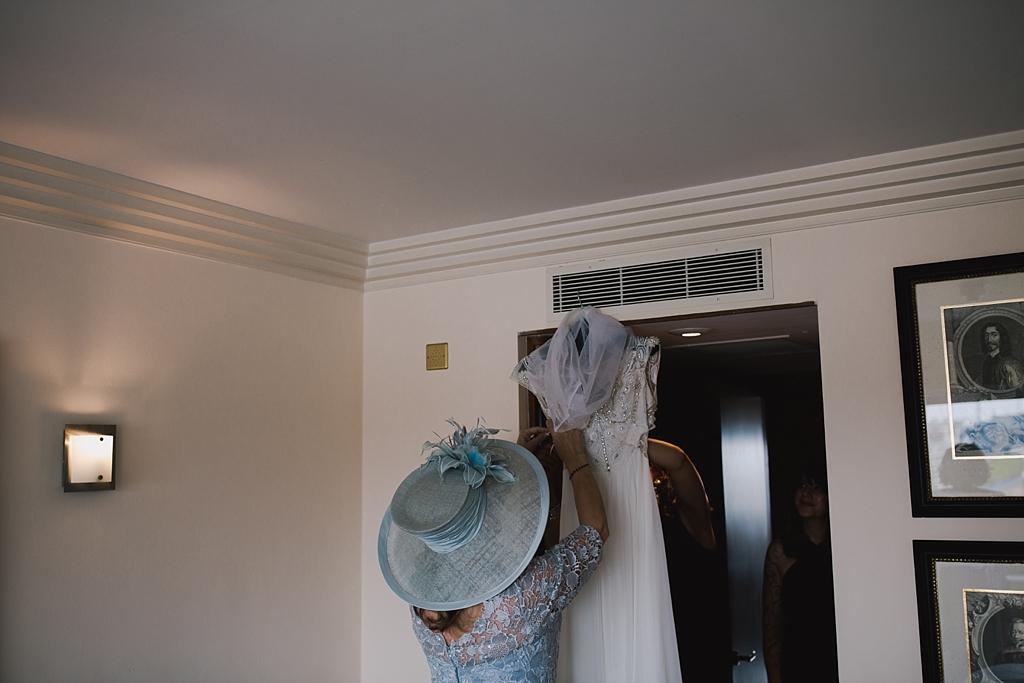 Brides mum getting the Jenny Packham wedding dress ready