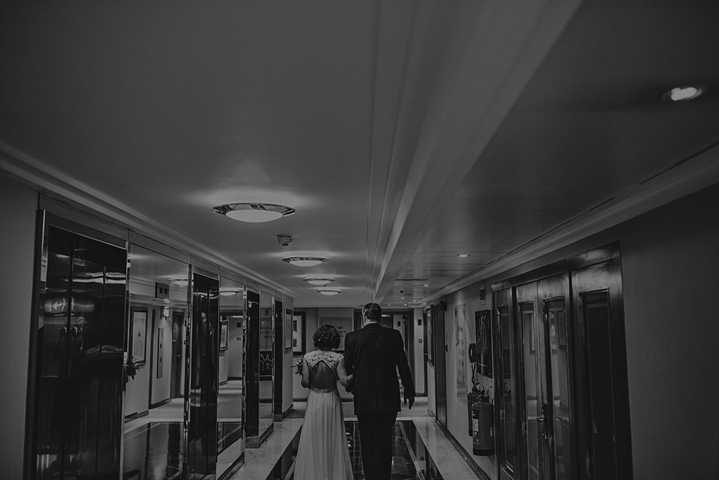 Bride with her dad walking to lift before the wedding ceremony