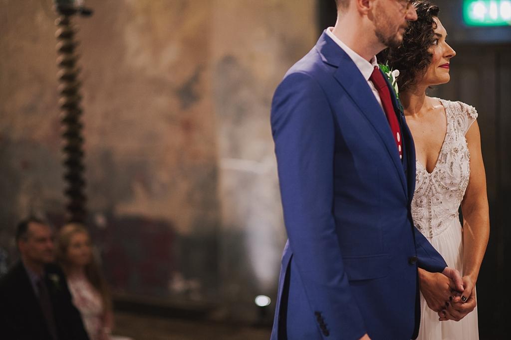 bride and groom at wedding ceremony   Wiltons Music Hall Wedding Photographer   Lisa Jane Photography