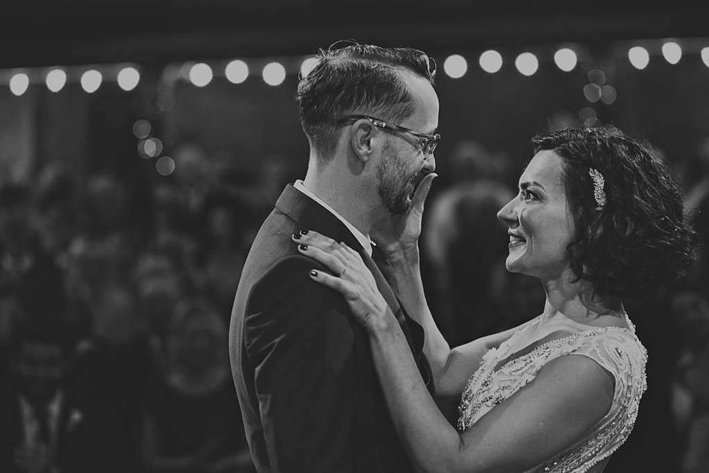 bride wipes away a lipstick mark on her groom after their first kiss   Wiltons Music Hall Wedding Photographer   Lisa Jane Photography