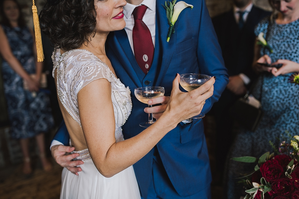 Bride & groom holding each other during drinks reception at a Wiltons Music Hall Wedding