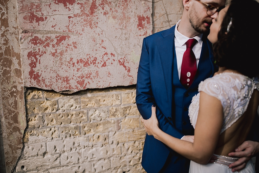 Bride and groom kissing outside Wiltons Music Hall   Creative, modern wedding photography by Lisa Jane Photography