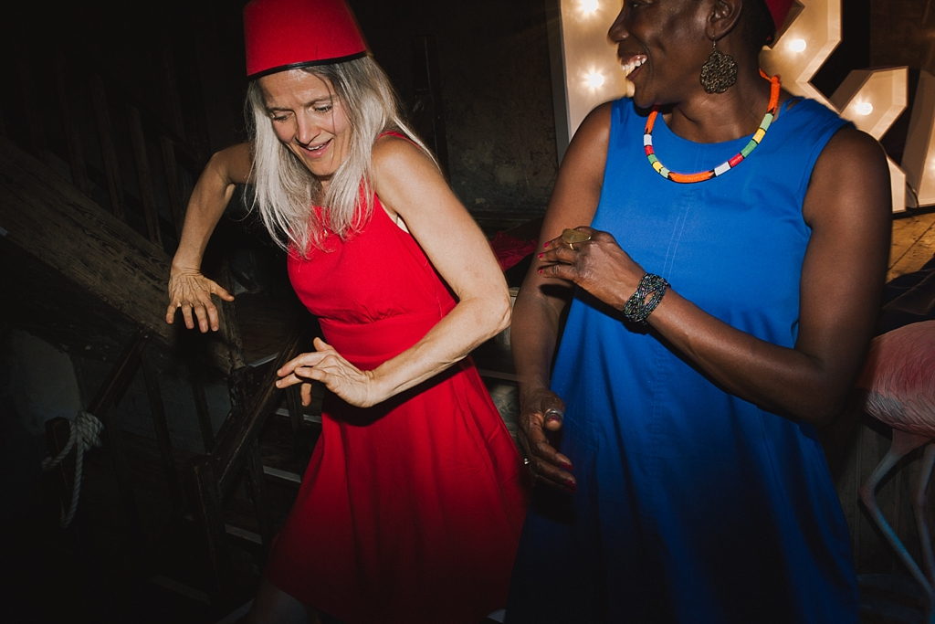 guests at a Wiltons music hall wedding dancing the night away   Wiltons Music Hall Wedding Photographer   Lisa Jane Photography