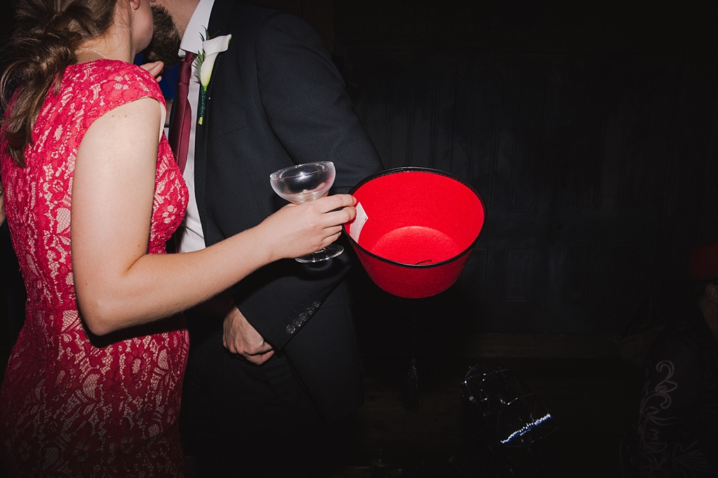 dancing with a glass of champagne and a fez   Creative modern wedding photography