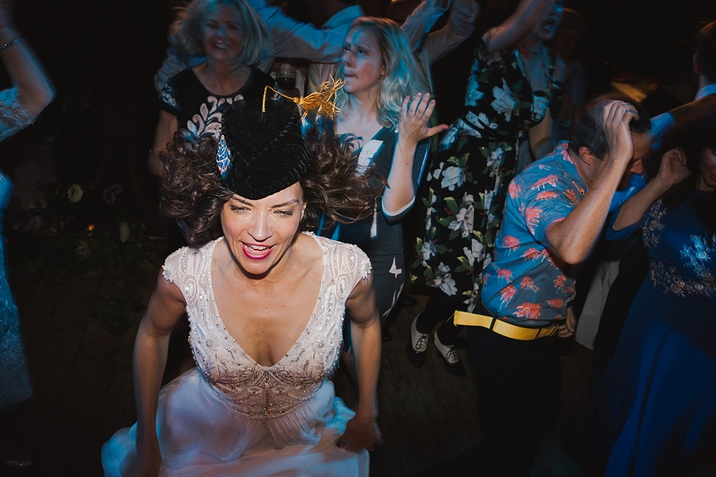 Bride dancing to Chas & Dave at a Wiltons Music Hall Wedding