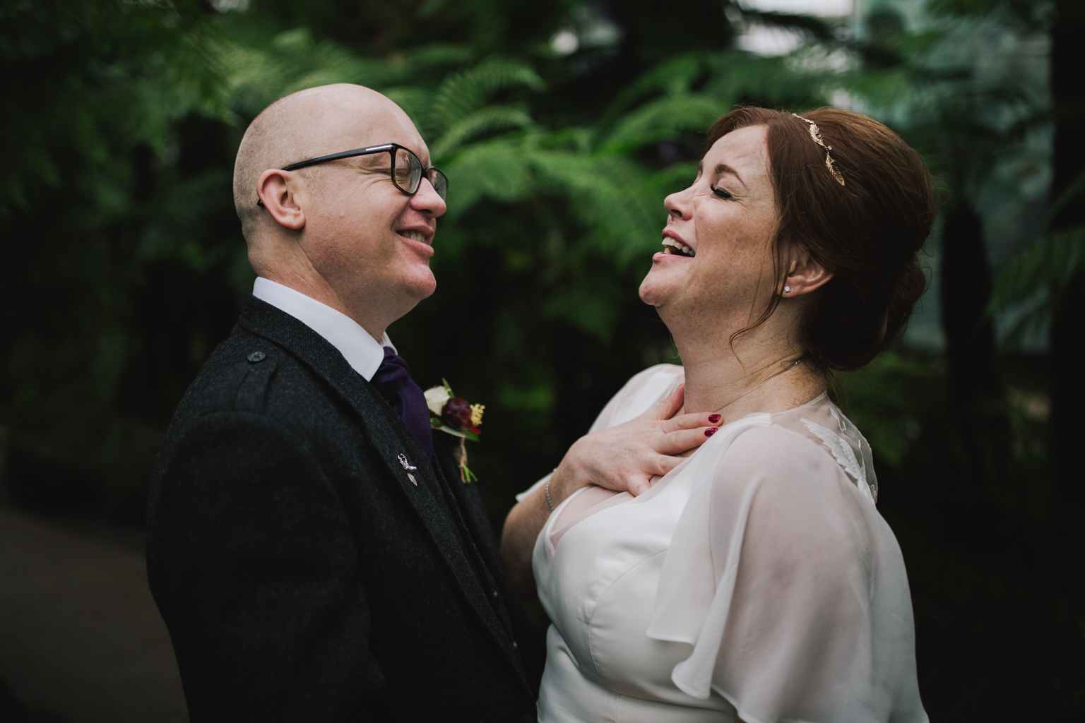 bride and groom laughing during their wedding at Glasgow Botanic Gardens by Lisa Jane Photography