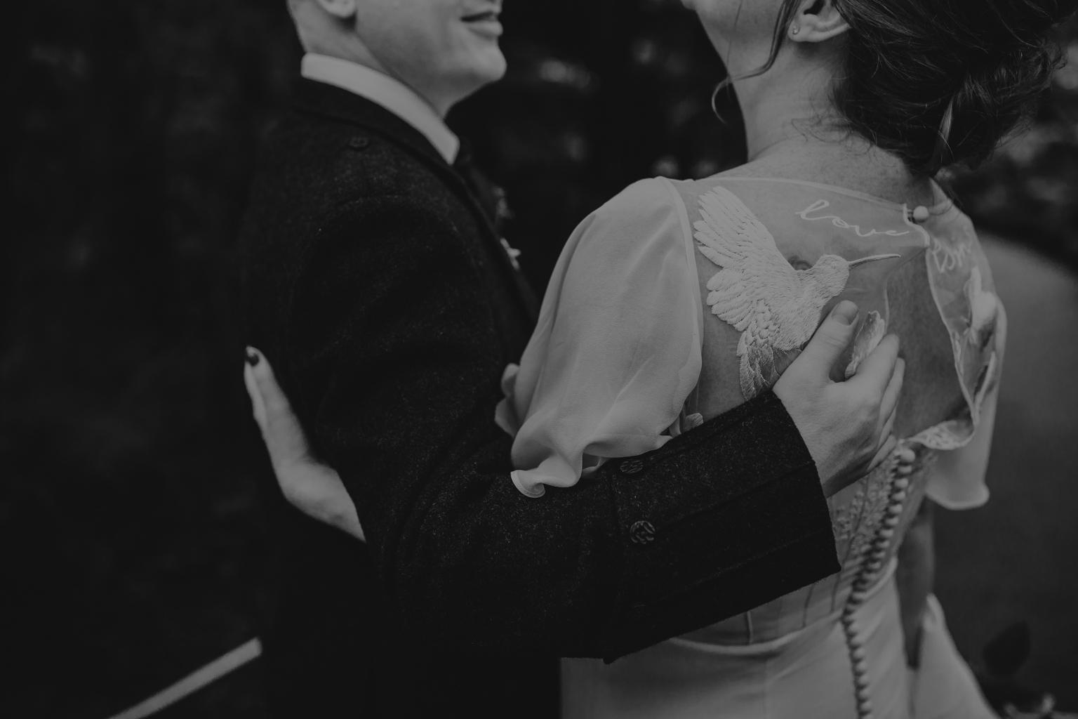 Bride and groom embracing at their Glasgow Botanic Gardens Wedding