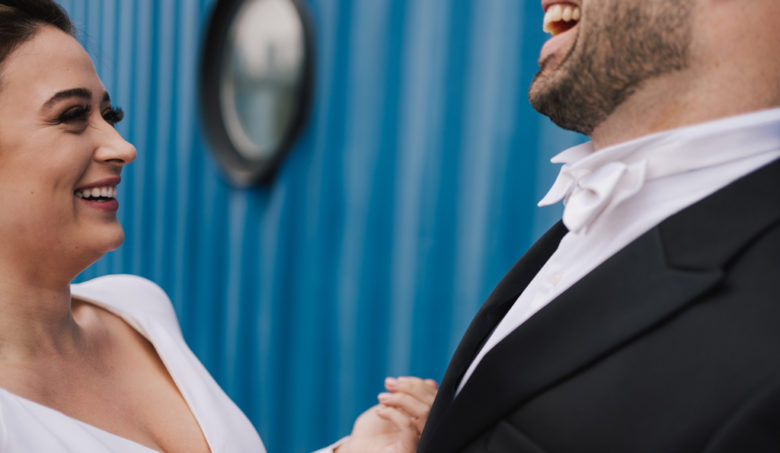 Bride and groom laughing at a Electrcians Shop Wedding by Lisa Jane Photography